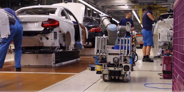 Our freely mobile robot working safely alongside associates (with BMW)